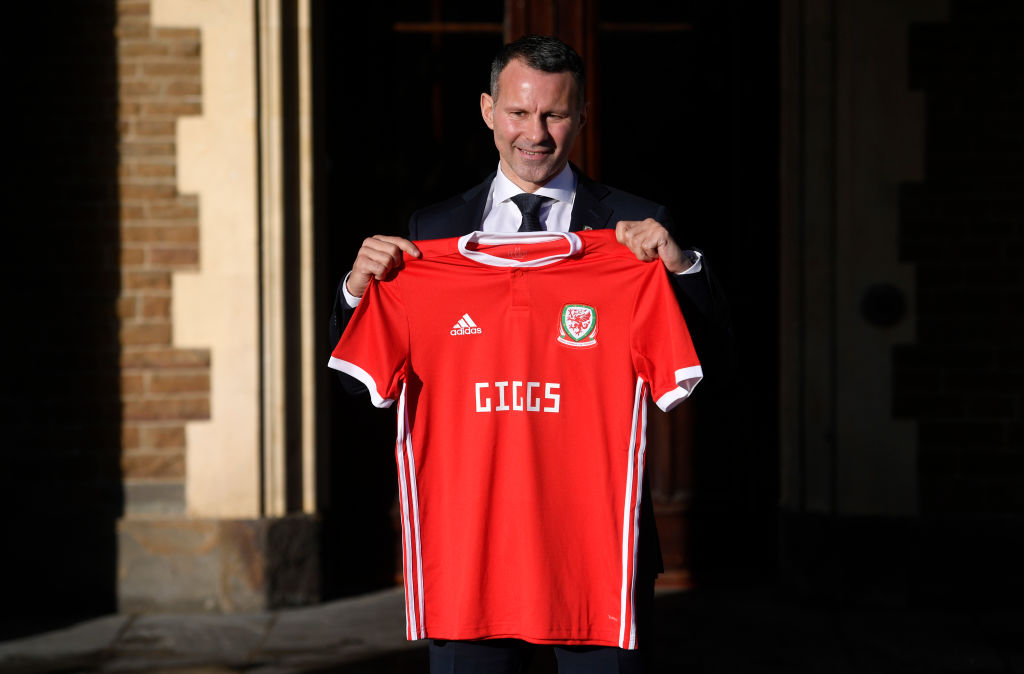 Ryan Giggs poses with a Welsh shirt