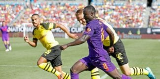 CHARLOTTE, NC - JULY 22: Naby Keita #8 of Liverpool controls the dribble as he moves towards the goal and is chased by Amos Pieper #42 and Herbert Bockhorn #39 of Borussia Dortmund during an International Champions Cup match at Bank of America Stadium on July 22, 2018 in Charlotte, North Carolina. (Photo by Bob Leverone/Getty Images)