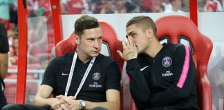 SINGAPORE, SINGAPORE - JULY 28: Julian Draxler of and Marco Verratti of Paris Saint Germain talk to each other on the bench before the International Champions Cup match between Arsenal and Paris Saint Germain at the National Stadium on July 28, 2018 in Singapore. (Photo by Lionel Ng/Getty Images)