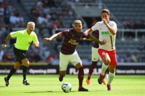 NEWCASTLE UPON TYNE, ENGLAND - AUGUST 04: DeAndre Yedlin of Newcastle United is tackled by Rani Khedira of FC Augsburg during the Pre-Season Friendly match between Newcastle United and FC Augsburg at St James' Park on August 4, 2018 in Newcastle upon Tyne, England. (Photo by Tony Marshall/Getty Images)