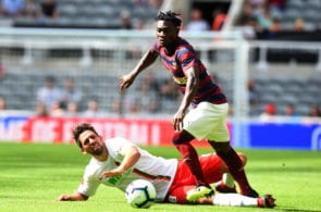 NEWCASTLE UPON TYNE, ENGLAND - AUGUST 04: Christian Atsu of Newcastle United is tackled by Rani Khedira of FC Augsburg during the Pre-Season Friendly match between Newcastle United and FC Augsburg at St James' Park on August 4, 2018 in Newcastle upon Tyne, England. (Photo by Tony Marshall/Getty Images)