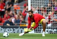 LIVERPOOL, ENGLAND - AUGUST 07: Alisson Becker of Liverpool warms up during the pre-season friendly match between Liverpool and Torino at Anfield on August 7, 2018 in Liverpool, England. (Photo by Jan Kruger/Getty Images)