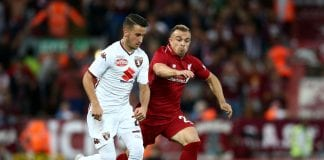 LIVERPOOL, ENGLAND - AUGUST 07: Xherdan Shaqiri of Liverpool battles with Alejandro Berenguer of Torino during the pre-season friendly match between Liverpool and Torino at Anfield on August 7, 2018 in Liverpool, England. (Photo by Jan Kruger/Getty Images)