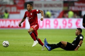FRANKFURT AM MAIN, GERMANY - AUGUST 12: Marco Fabian of Frankfurt (R) challenges Thiago of Bayern (L) during the DFL Supercup match between Eintracht Frankfurt an Bayern Muenchen at Commerzbank-Arena on August 12, 2018 in Frankfurt am Main, Germany. (Photo by Christof Koepsel/Bongarts/Getty Images)
