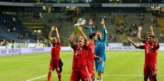 FRANKFURT AM MAIN, GERMANY - AUGUST 12: Joshua Kimmich of Bayern lifts the trophy after winning 5-0 the DFL Supercup match between Eintracht Frankfurt an Bayern Muenchen at Commerzbank-Arena on August 12, 2018 in Frankfurt am Main, Germany. (Photo by Christof Koepsel/Bongarts/Getty Images)