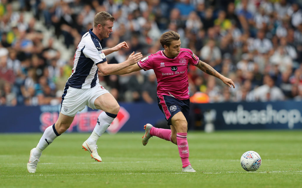 WEST BROMWICH, ENGLAND - AUGUST 18: Luke Freeman of Queens Park Rangers moves away from Chris Brunt during the Sky Bet Championship match between West Bromwich Albion and Queens Park Rangers at The Hawthorns on August 18, 2018 in West Bromwich, England. (Photo by David Rogers/Getty Images)