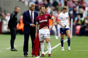 LONDON, ENGLAND - AUGUST 18: Manuel Pellegrini, Manager of West Ham United talks with Jack Wilshere of West Ham United during the Premier League match between West Ham United and AFC Bournemouth at London Stadium on August 18, 2018 in London, United Kingdom. (Photo by Henry Browne/Getty Images)