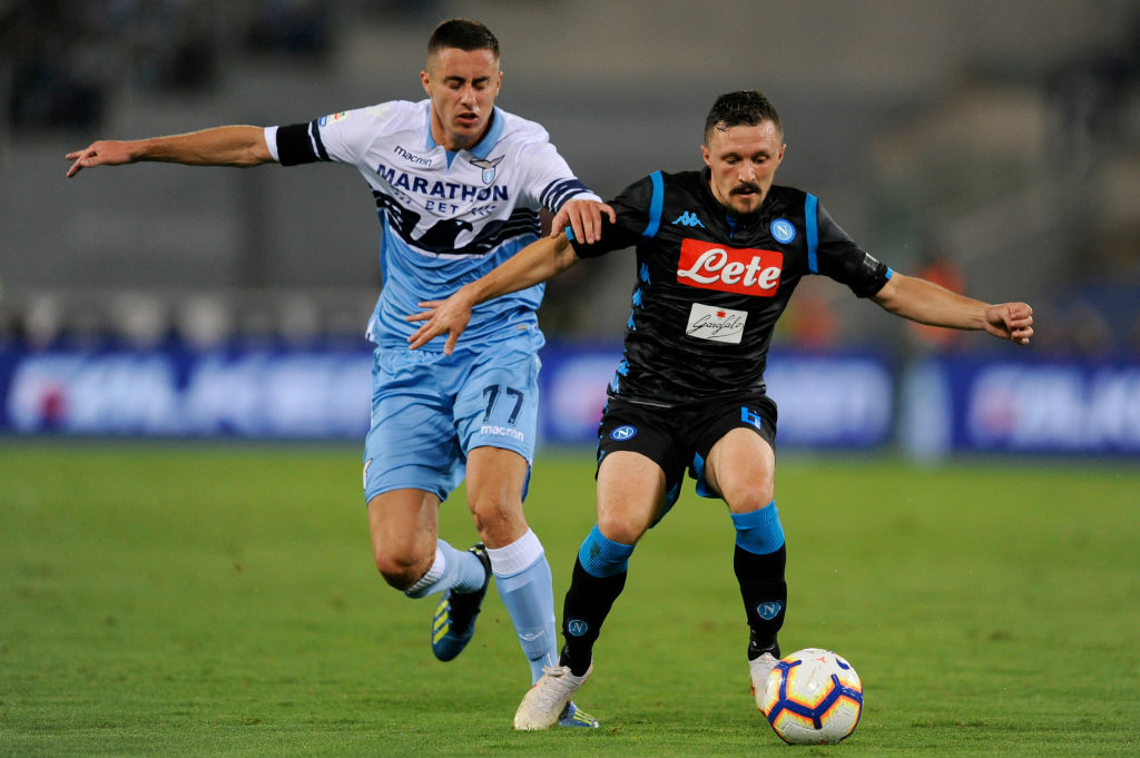 ROME, ITALY - AUGUST 18: Mario Rui of SSC Napoli competes for the ball with Adam Marusic of SS Lazio during the serie A match between SS Lazio and SSC Napoli at Stadio Olimpico on August 18, 2018 in Rome, Italy. (Photo by Marco Rosi/Getty Images)