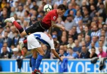 BRIGHTON, ENGLAND - AUGUST 19: Victor Lindelof of Manchester United collides with Glenn Murray of Brighton and Hove Albion during the Premier League match between Brighton & Hove Albion and Manchester United at American Express Community Stadium on August 19, 2018 in Brighton, United Kingdom. (Photo by Mike Hewitt/Getty Images)
