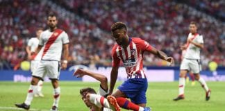 MADRID, SPAIN - AUGUST 25: Thomas Lemar of Club Atletico de Madrid is challenged by Gorka Elustondo Urkola of Rayo Vallecano de Madrid during the La Liga match between Club Atletico de Madrid and Rayo Vallecano de Madrid at Wanda Metropolitano on August 25, 2018 in Madrid, Spain. (Photo by Denis Doyle/Getty Images)
