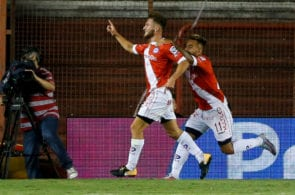 BUENOS AIRES, ARGENTINA - MARCH 05: Alexis Mac Allister of Argentinos Juniors celebrates with teammates after scoring the first goal of his team during a match between Argentinos Juniors and Boca Juniors as part of Superliga 2017/18 at Diego Armando Maradona Stadium on March 5, 2018 in Buenos Aires, Argentina. (Photo by Gabriel Rossi/Getty Images)