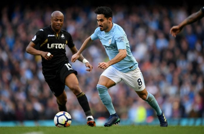 MANCHESTER, ENGLAND - APRIL 22: Andre Ayew of Swansea City and Ilkay Gundogan of Manchester City battle for the ball during the Premier League match between Manchester City and Swansea City at Etihad Stadium on April 22, 2018 in Manchester, England. (Photo by Laurence Griffiths/Getty Images)