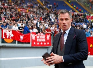 ROME, ITALY - MAY 02: Former Liverpool player, Jamie Carragher is pictured infront of the traveling fans prior to the UEFA Champions League Semi Final Second Leg match between A.S. Roma and Liverpool at Stadio Olimpico on May 2, 2018 in Rome, Italy. (Photo by Julian Finney/Getty Images)