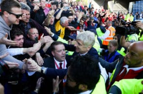 HUDDERSFIELD, ENGLAND - MAY 13: Arsene Wenger manager / head coach of Arsenal is surrounded by stewards as he greets the fans after the Premier League match between Huddersfield Town and Arsenal at John Smith's Stadium on May 13, 2018 in Huddersfield, England. (Photo by Catherine Ivill/Getty Images)