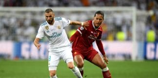 KIEV, UKRAINE - MAY 26: Karim Benzema of Real Madrid holds off Virgil van Dijk of Liverpool during the UEFA Champions League Final between Real Madrid and Liverpool at NSC Olimpiyskiy Stadium on May 26, 2018 in Kiev, Ukraine. (Photo by Shaun Botterill/Getty Images)
