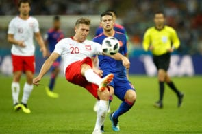 KAZAN, RUSSIA - JUNE 24: Lukasz Piszczek of Poland is challenged by James Rodriguez of Colombia during the 2018 FIFA World Cup Russia group H match between Poland and Colombia at Kazan Arena on June 24, 2018 in Kazan, Russia. (Photo by Julian Finney/Getty Images)