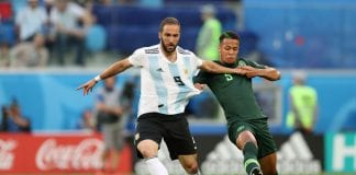 SAINT PETERSBURG, RUSSIA - JUNE 26: Gonzalo Higuain of Argentina is tackled by William Ekong of Nigeria during the 2018 FIFA World Cup Russia group D match between Nigeria and Argentina at Saint Petersburg Stadium on June 26, 2018 in Saint Petersburg, Russia. (Photo by Alex Morton/Getty Images)