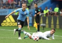 NIZHNY NOVGOROD, RUSSIA - JULY 06: Antoine Griezmann of France is challenged by Diego Laxalt of Uruguay during the 2018 FIFA World Cup Russia Quarter Final match between Uruguay and France at Nizhny Novgorod Stadium on July 6, 2018 in Nizhny Novgorod, Russia. (Photo by Alexander Hassenstein/Getty Images)
