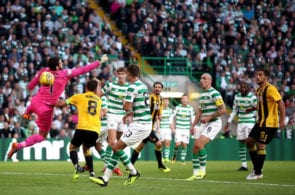 GLASGOW, SCOTLAND - AUGUST 08: Craig Gordon of Celtic attempts to save the ball during the UEFA Champions League Qualifier between Celtic and AEK Athens at Celtic Park Stadium on August 8, 2018 in Glasgow, Scotland. (Photo by Julian Finney/Getty Images)