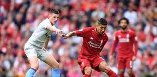 LIVERPOOL, ENGLAND - AUGUST 12: Roberto Firmino of Liverpool is challenged by Declan Rice of West Ham United during the Premier League match between Liverpool FC and West Ham United at Anfield on August 12, 2018 in Liverpool, United Kingdom. (Photo by Laurence Griffiths/Getty Images)