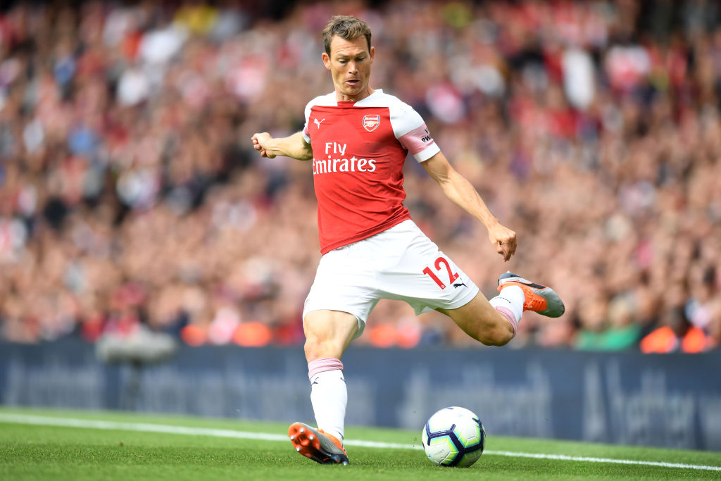 LONDON, ENGLAND - AUGUST 12: Stephan Lichtsteiner of Arsenal in action during the Premier League match between Arsenal FC and Manchester City at Emirates Stadium on August 12, 2018 in London, United Kingdom. (Photo by Michael Regan/Getty Images)