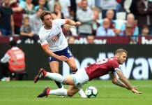 LONDON, ENGLAND - AUGUST 18: Dan Gosling of AFC Bournemouth tackles Jack Wilshere of West Ham United during the Premier League match between West Ham United and AFC Bournemouth at London Stadium on August 18, 2018 in London, United Kingdom. (Photo by Marc Atkins/Getty Images)