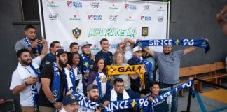 LOS ANGELES, CA - AUGUST 22: A group of LA Galaxy fans pose for photos at the MLS Heineken Rivalry Week Secret Walls event held at START Los Angeles on August 22, 2018 in Los Angeles, California. (Photo by Meg Oliphant/Getty Images)