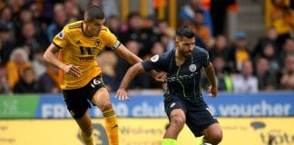 WOLVERHAMPTON, ENGLAND - AUGUST 25: Wolves captain Conor Coady (l) challenges Sergio Aguero of City during the Premier League match between Wolverhampton Wanderers and Manchester City at Molineux on August 25, 2018 in Wolverhampton, United Kingdom. (Photo by Stu Forster/Getty Images)