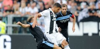 TURIN, ITALY - AUGUST 25: Lucas Leiva of SS Lazio compete for the ball with Sami Khedira of Juventus during the serie A match between Juventus and SS Lazio on August 25, 2018 in Turin, Italy. (Photo by Marco Rosi/Getty Images)