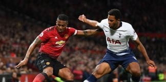 MANCHESTER, ENGLAND - AUGUST 27: Antonio Valencia of Manchester United and Mousa Dembele of Tottenham Hotspur battle for possession during the Premier League match between Manchester United and Tottenham Hotspur at Old Trafford on August 27, 2018 in Manchester, United Kingdom. (Photo by Clive Mason/Getty Images)
