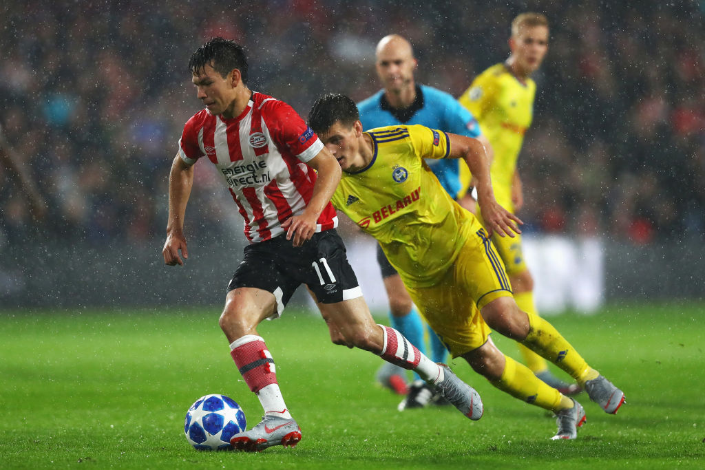EINDHOVEN, NETHERLANDS - AUGUST 29: Hirving Lozano of PSV gets past the tackle from Stanislaw Dragun of BATE Borisov during the UEFA Champions League Play-offs , 2nd leg match between PSV and FC BATE Borisov at Phillips Stadium on August 29, 2018 in Eindhoven, Netherlands. (Photo by Dean Mouhtaropoulos/Getty Images)