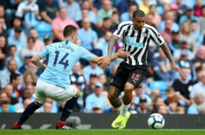 MANCHESTER, ENGLAND - SEPTEMBER 01: Kenedy of Newcastle United is challenged by Aymeric Laporte of Manchester City during the Premier League match between Manchester City and Newcastle United at Etihad Stadium on September 1, 2018 in Manchester, United Kingdom. (Photo by Alex Livesey/Getty Images)