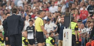 MADRID, SPAIN - SEPTEMBER 01: Referee Jaime Latre examines the VAR before awarding Real's 2nd goal during the La Liga match between Real Madrid CF and CD Leganes at Estadio Santiago Bernabeu on September 1, 2018 in Madrid, Spain. (Photo by Denis Doyle/Getty Images)