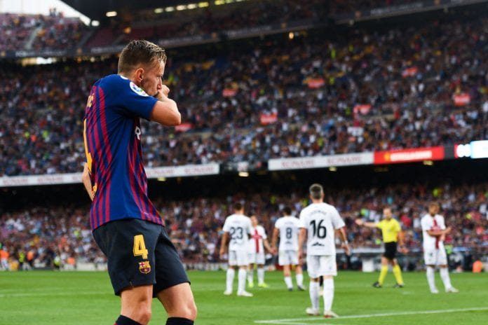 BARCELONA, SPAIN - SEPTEMBER 02: Ivan Rakitic of FC Barcelona celebrates after scoring his team's fifth goal during the La Liga match between FC Barcelona and SD Huesca at Camp Nou on September 2, 2018 in Barcelona, Spain. (Photo by David Ramos/Getty Images)