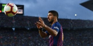 BARCELONA, SPAIN - SEPTEMBER 02: Luis Suarez of FC Barcelona grabs the ball during the La Liga match between FC Barcelona and SD Huesca at Camp Nou on September 2, 2018 in Barcelona, Spain. (Photo by David Ramos/Getty Images)