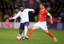 LEICESTER, ENGLAND - SEPTEMBER 11: Danny Rose of England battles with Stephan Lichtsteiner of Switzerland during the international friendly match between England and Switzerland at The King Power Stadium on September 11, 2018 in Leicester, United Kingdom. (Photo by Laurence Griffiths/Getty Images)