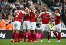 NEWCASTLE UPON TYNE, ENGLAND - SEPTEMBER 15: Mesut Ozil of Arsenal celebrates after scoring his team's second goal with team mates during the Premier League match between Newcastle United and Arsenal FC at St. James Park on September 15, 2018 in Newcastle upon Tyne, United Kingdom. (Photo by Alex Livesey/Getty Images)
