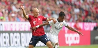 MUNICH, GERMANY - SEPTEMBER 15: Arjen Robben (L) of Bayern Muenchen battles for the ball with Wendell of Leverkusen during the Bundesliga match between FC Bayern Muenchen and Bayer 04 Leverkusen at Allianz Arena on September 15, 2018 in Munich, Germany. (Photo by Alexander Hassenstein/Bongarts/Getty Images)