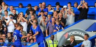 LONDON, ENGLAND - SEPTEMBER 15: Maurizio Sarri manager of Chelsea congratulates Eden Hazard on his hat-trick as fans and coaching staff give a standing ovation during the Premier League match between Chelsea FC and Cardiff City at Stamford Bridge on September 15, 2018 in London, United Kingdom. (Photo by Marc Atkins/Getty Images)