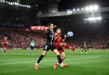 LIVERPOOL, ENGLAND - SEPTEMBER 18: Trent Alexander-Arnold of Liverpool battles for possession with Edinson Cavani of Paris Saint-Germain during the Group C match of the UEFA Champions League between Liverpool and Paris Saint-Germain at Anfield on September 18, 2018 in Liverpool, United Kingdom. (Photo by Michael Regan/Getty Images)