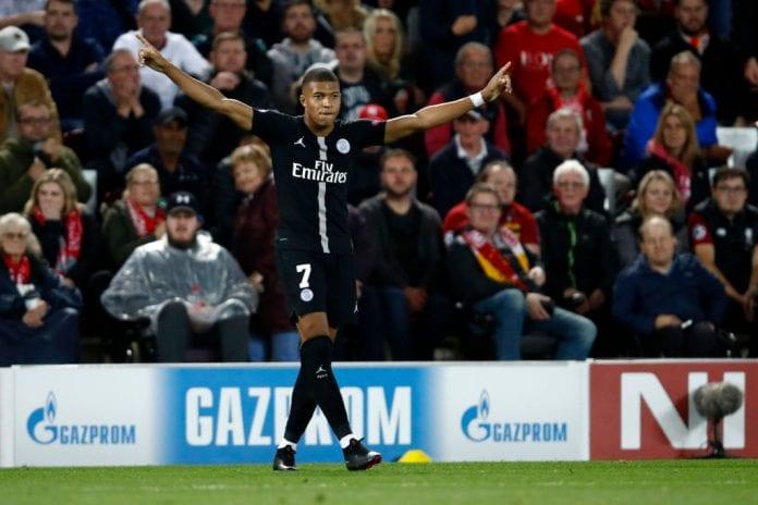 low priced 61edf 7dbd7 Kylian Mbappe shows off his signed Pele shirt - Ronaldo.com