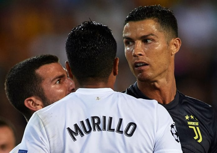 VALENCIA, SPAIN - SEPTEMBER 19: Jose Luis Gaya and Jeison Murillo of Valencia argue to Cristano Ronaldo of Juventus during the Group H match of the UEFA Champions League between Valencia and Juventus at Estadio Mestalla on September 19, 2018 in Valencia, Spain. (Photo by Manuel Queimadelos Alonso/Getty Images)