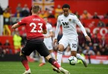 MANCHESTER, ENGLAND - SEPTEMBER 22: Helder Costa of Wolverhampton Wanderers runs with the ball under pressure from Luke Shaw of Manchester United during the Premier League match between Manchester United and Wolverhampton Wanderers at Old Trafford on September 22, 2018 in Manchester, United Kingdom. (Photo by Ross Kinnaird/Getty Images)
