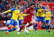 LIVERPOOL, ENGLAND - SEPTEMBER 22: Wesley Hoedt of Southampton is challenged by Mohamed Salah of Liverpool during the Premier League match between Liverpool FC and Southampton FC at Anfield on September 22, 2018 in Liverpool, United Kingdom. (Photo by Alex Livesey/Getty Images)
