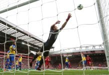 LIVERPOOL, ENGLAND - SEPTEMBER 22: Joel Matip of Liverpool scores his team's second goal past Alex McCarthy of Southampton during the Premier League match between Liverpool FC and Southampton FC at Anfield on September 22, 2018 in Liverpool, United Kingdom. (Photo by Alex Livesey/Getty Images)