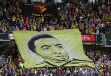 WATFORD, ENGLAND - SEPTEMBER 15: A Troy Deeney banner is displayed during the Premier League match between Watford FC and Manchester United at Vicarage Road on September 15, 2018 in Watford, United Kingdom. (Photo by Richard Heathcote/Getty Images)