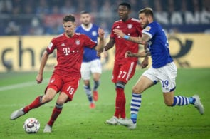 GELSENKIRCHEN, GERMANY - SEPTEMBER 22: Leon Goretzka #18 of Bayern Munich and Guido Burgstaller #19 of FC Schalke 04 battle for the ball during the Bundesliga match between FC Schalke 04 and FC Bayern Muenchen at Veltins-Arena on September 22, 2018 in Gelsenkirchen, Germany. (Photo by Maja Hitij/Bongarts/Getty Images)