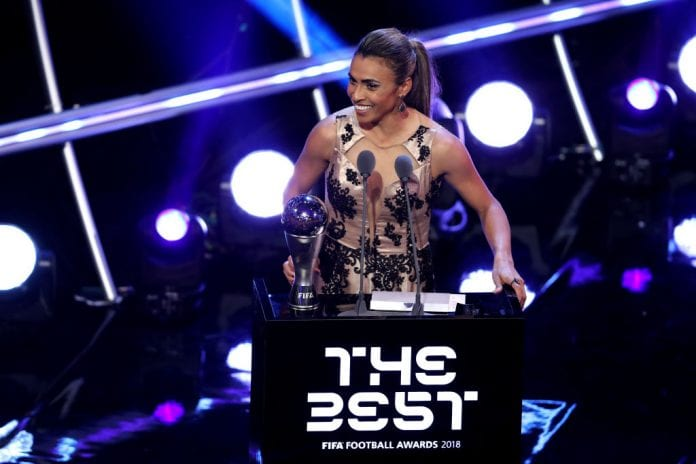 LONDON, ENGLAND - SEPTEMBER 24: Marta of Orlando Pride receives the trophy for The Best FIFA Women's Player 2018 during the The Best FIFA Football Awards Show at Royal Festival Hall on September 24, 2018 in London, England. (Photo by Dan Istitene/Getty Images)