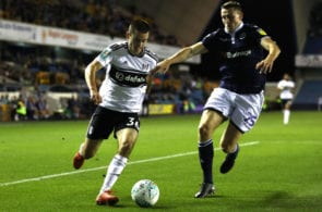 LONDON, ENGLAND - SEPTEMBER 25: Luca de la Torre of Fulham is challenged by Murray Wallace of Millwall during the Carabao Cup Third Round match between Millwall and Fulham at The Den on September 25, 2018 in London, England. (Photo by Bryn Lennon/Getty Images)