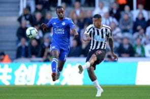 NEWCASTLE UPON TYNE, ENGLAND - SEPTEMBER 29: Kenedy of Newcastle United and Ricardo Pereira of Leicester City competes for the ball during the Premier League match between Newcastle United and Leicester City at St. James Park on September 29, 2018 in Newcastle upon Tyne, United Kingdom. (Photo by Mark Runnacles/Getty Images)